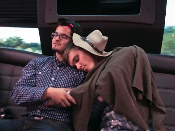 After a Memorial Day barbecue, Ben Bartenstein, right, and Santiago Mejia take a moment to rest on the bus ride back.