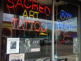 Charles, a missing poodle terrier mix, was last seen at the Sacred Art Tattoo studio on Sunday.
