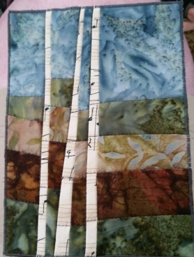 Birches- I love the use of fabric with music on it for the birches