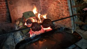 roasting beef in front of the great fire