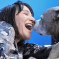 Sherri smiling with a happy pitbull