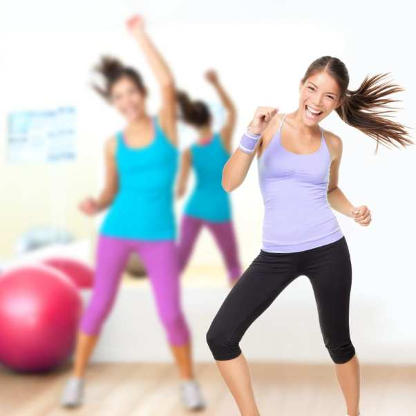 happy women taking a fitness class