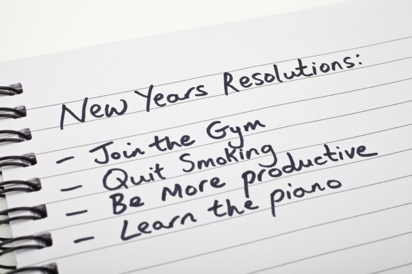 New Year's Resolutions written on a note pad.
