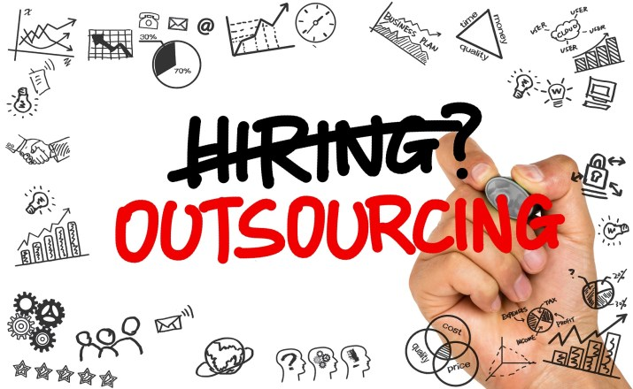 hiring or outsourcing concept handwritten on whiteboard