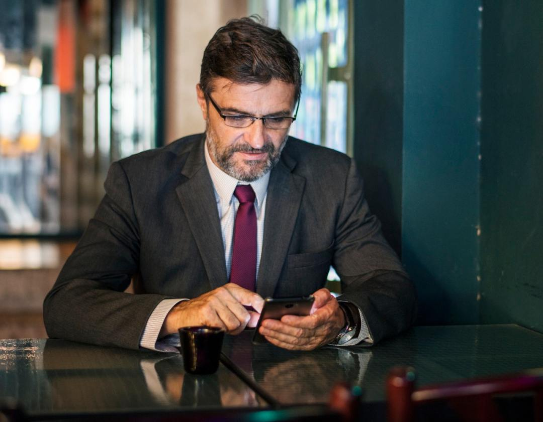 businessman using cellphone in the table