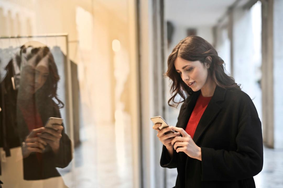 woman using phone while walking