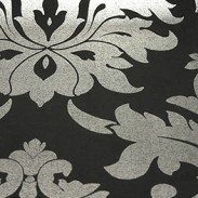 The Damask Drama roller blind is truly stunning, take a matt black blind and then give it a glamorous twist with a traditional damask pattern. The damask pattern is picked out in an appealing silver shimmer that catches the light and adds a touch of lightness to the deep black of the blind.