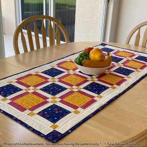 charming-squares-quilted-table-topper-tulip-square-patterns