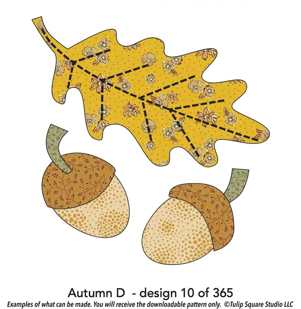 Graphic of a leaf with a golden flowered pattern on it, with two acorns beneath the leaf