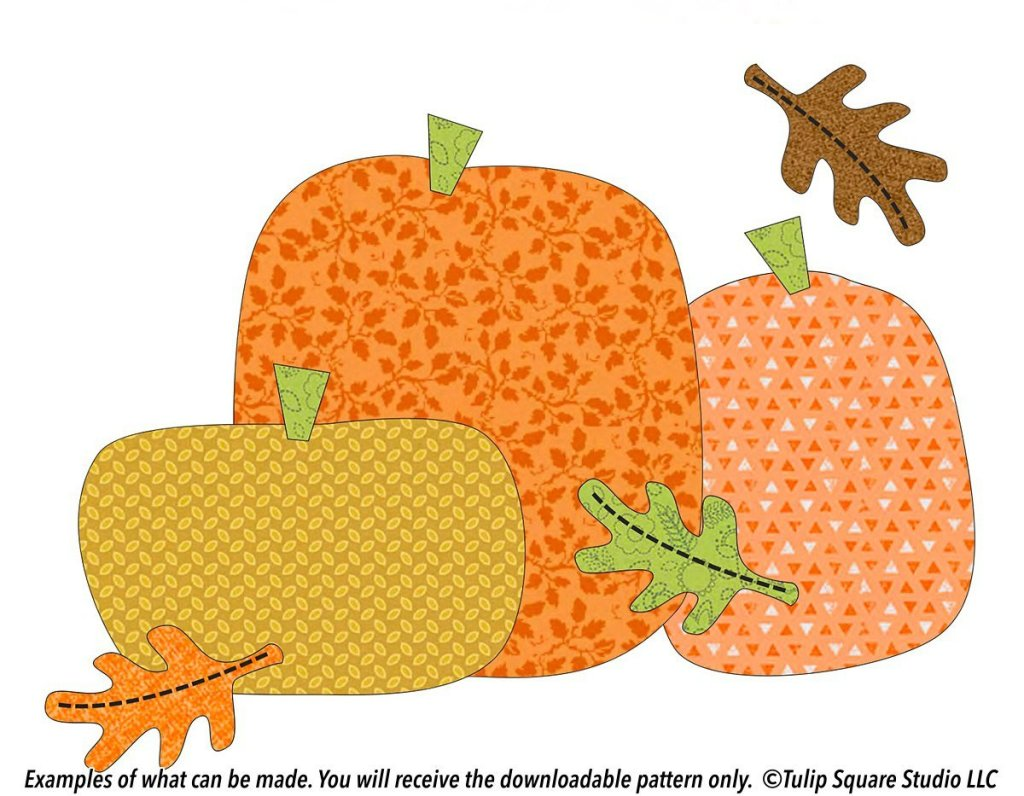 Three chunky pumpkins made of whimsical patterned fabric, with autumn leaves falling around them.