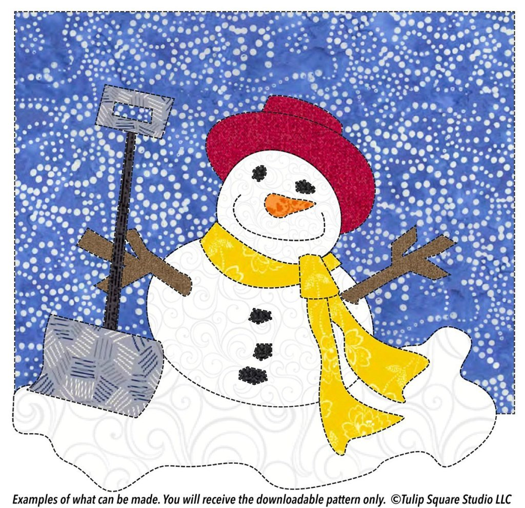 Drawing of a happy snowman, created in fabric scraps, on a background of blue fabric with white swirls.