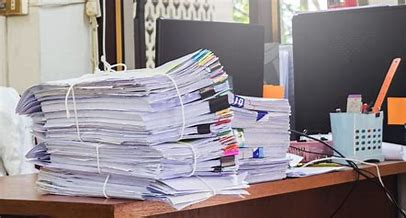 piles of paper can cause stress