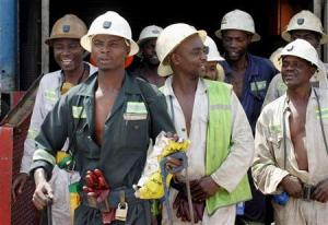 Zambian miners walk out of a lift at Konkola Copper mine in Chililabombwe, Zambia.