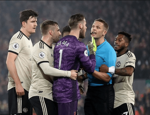 Manchester United hit with £20,000 FA fine over players surrounding referee Craig Pawson during Liverpool clash