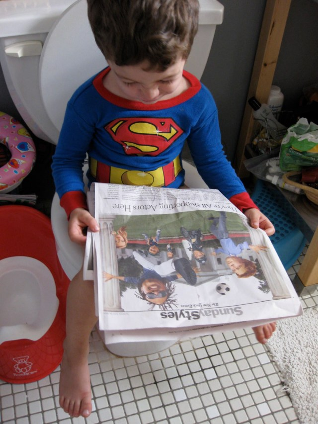 Tuned In Parents - Potty Training Like a Boss, Superman reads the styles section, photo by Valentina Powers, Creative Commons