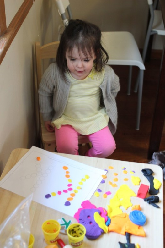 Here are a handful of toddler montessori-inspired activities we tried at home. They're pretty easy to set up and very cheap or free. Great for a 2 year old!