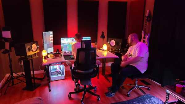 2 artist listen back to their music at Tunes Recording Studio