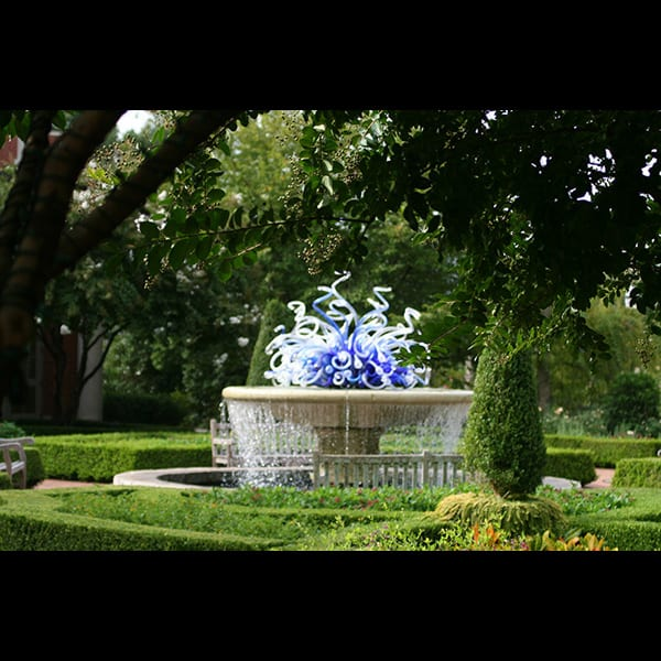 The Wilmer Fountain with a Chihuly scuplture in the Parterre Garden at the Atlanta Botanical Garden in Atlanta, Georgia, designed by Tunnell and Tunnell Landscape Architecture.