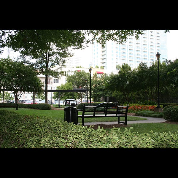 Bench in the rear courtyard at the Biltmore Hotel and Apartments in Atlanta, Georgia, landscape by Tunnell and Tunnell Landscape Architecture.