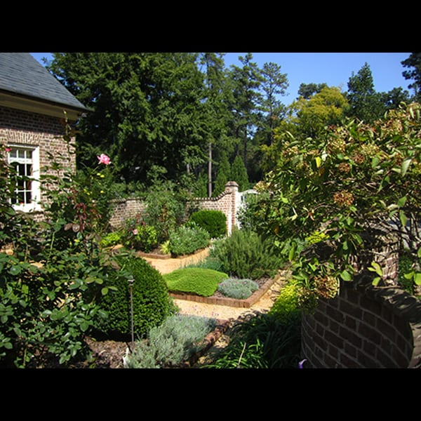 A view of the kitchen garden at an Atlanta residence, landscape designed by Tunnell and Tunnell Landscape Architecture.