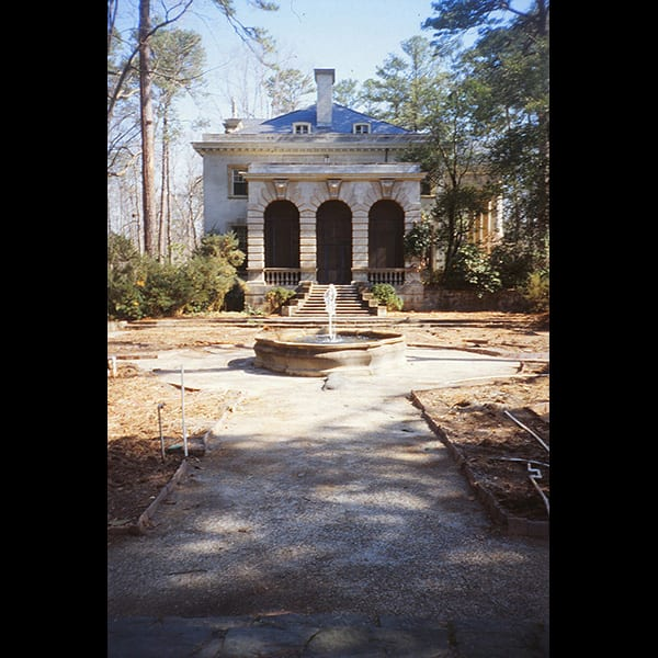 View of fountain and house from the Boxwood Garden at the Swan House in Atlanta, Georgia during construction, historic restoration by Tunnell and Tunnell Landscape Architecture.
