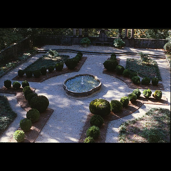 View of boxwoods and fountain in the Boxwood Garden at the Swan House in Atlanta, Georgia, historic restoration by Tunnell and Tunnell Landscape Architecture.