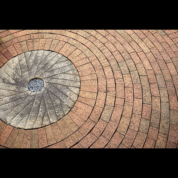 Millstone set in Brick Paving at Atlanta Botanical Garden
