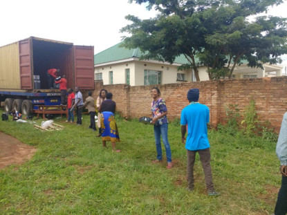 Volunteers unload the Turing Trust packages from the truck in Malawi.