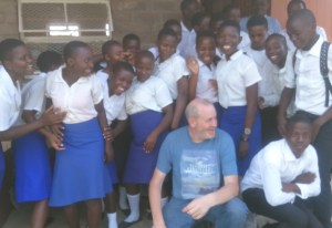 Neil Gilchrist with students in Malawi