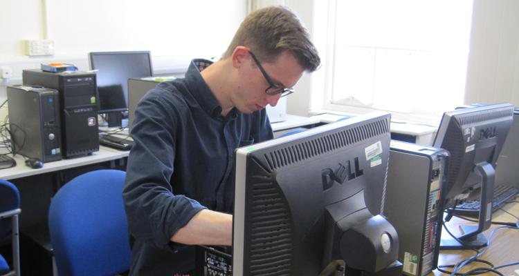 Volunteer refurbishing computers in Edinburgh