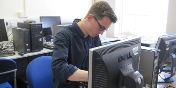 Volunteer refurbishing computer