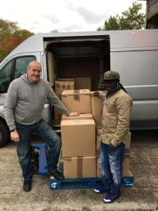 UK Jarra picking up computers from our warehouse in Edinburgh