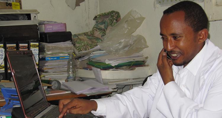 Dr Endale enjoys his new laptop in Ethiopia
