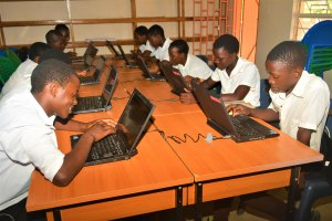 Students using laptops at Livingstonia Community Day Secondary School