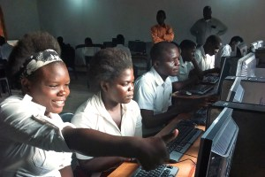 Students enjoying their new computer lab at Muhuju Community Day Secondary School