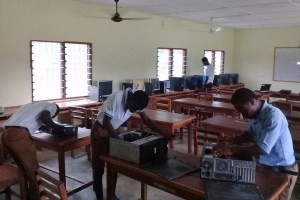 Students learning computer maintenance at Tetrefu ICCES, Ghana