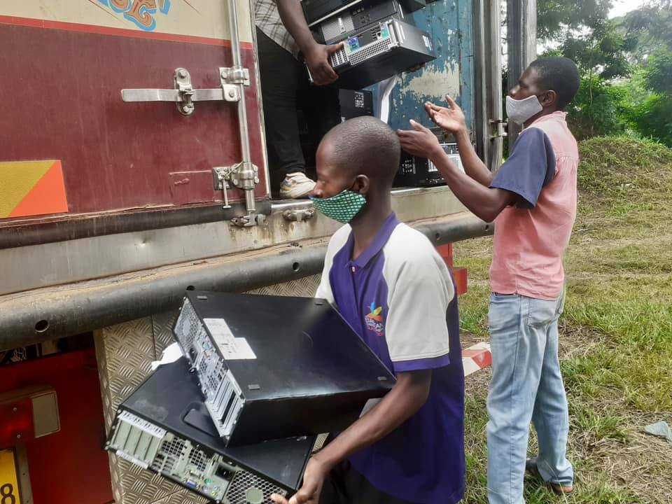 Delivering computers to schools in the Central Region in Malawi, February 2021
