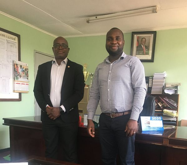 James Gondwe with the manager of the Central West Education Division