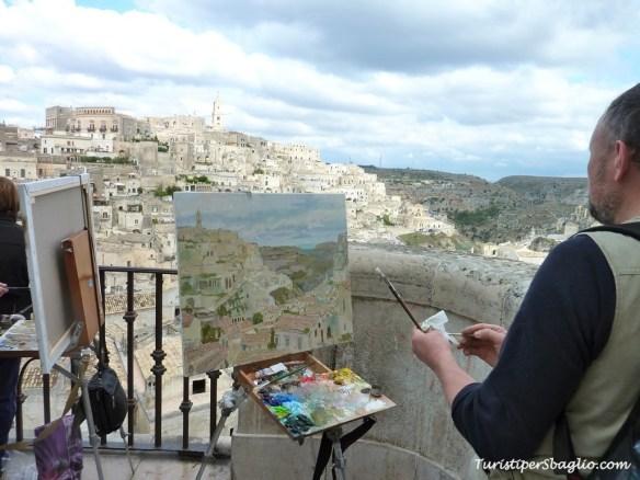 Artisti al lavoro in Piazza Pascoli