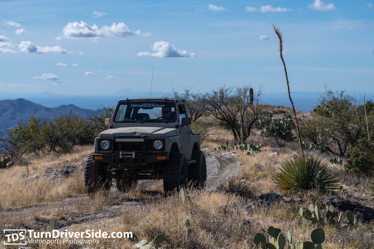 Daniel in his desert tan Suzuki Samurai on the Pucker Ridge Trail