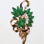 A Gold Spray Brooch set with 2 Diamonds and Jadeite Cabochons - 2x Old Cut European Diamonds -total 0.12cts, 17 Pears shaped, round and marquise cut Cabochons stamped 14ct and assessed as 14ct yellow gold -Chinese script to rear