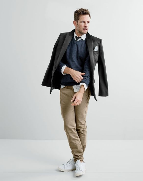 J.Crew men's Ludlow tuxedo jacket, rugged cotton V-neck sweater, slim Irish linen shirt in solid, broken-in chino in 770 urban slim fit, tie in black, English linen pocket square and New Balance® 791 leather sneakers.