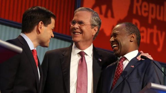 Republican presidential candidates from left, Marco Rubio, Jeb Bush and Ben Carson talk Thursday during a break in the first Republican presidential debate.  (Andrew Harnik / Associated Press)
