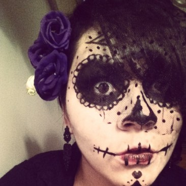 Did it up Day of the Dead style. it was last minute and I had to pull stuff together.