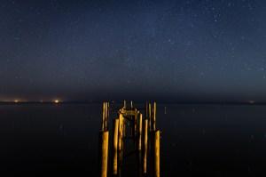 Starry sky over a dock