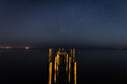 Starry sky over a dock