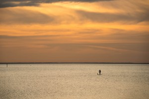 Paddle boarding on Mobile Bay at sunset