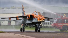 The final movement of the final RAF Jaguar, traditionally soaked by a water cannon salute.