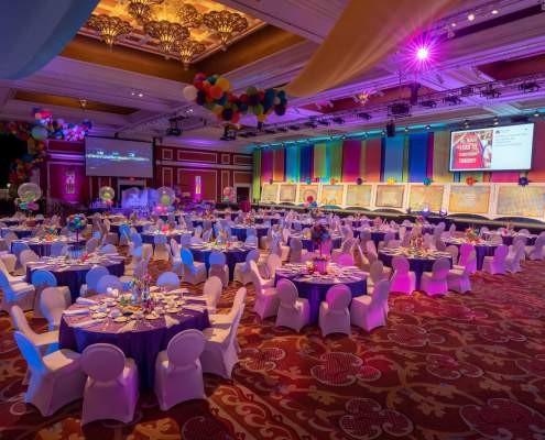 Alternating Satin Drapery Panels Hung from a Truss at a Las Vegas Event From Turn of Events Las Vegas Rental Drapery