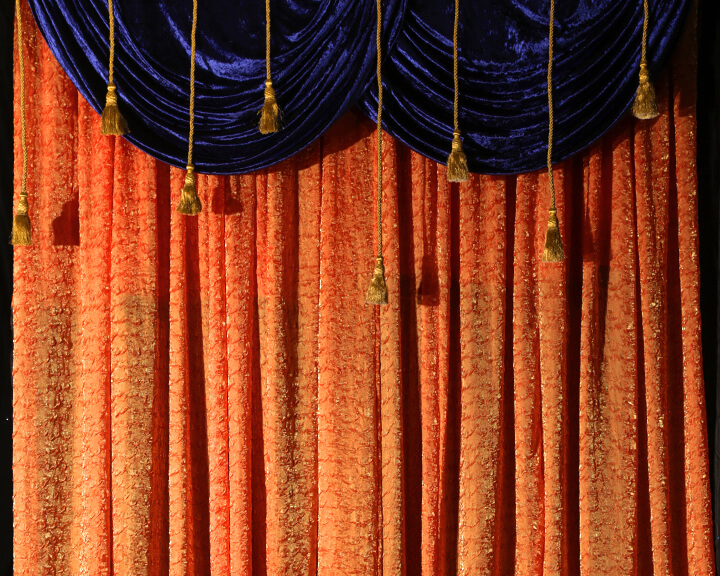 Citrus Sheer Drapery with a Blue Sapphire and Gold Tie Accent from Turn of Events Las Vegas